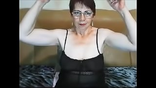 Pretty Russian GILF flexes her biceps